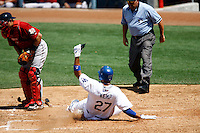 19 July 2009: Centerfielder Matt Kemp #27 slides into home base, he scored the only four runs of the game for his team during the MLB Los Angeles Dodgers 4-3 win over the Houston Astros on a warm summer day in LA at Chavez Ravine during a National League Professional Baseball game.