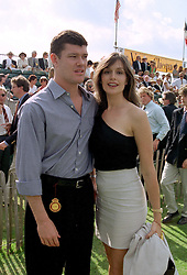MR JAMIE PACKER son of Kerry Packer the multi millionaire Australian media tycoon and his fiancee MISS KATE FISCHER, at a polo match in Sussex on 20th July 1997.MAM 95