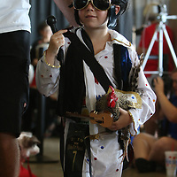 Gibson Criddle, 5, dressed as Elvis Saturday for the pet parade along with his rooster Dom