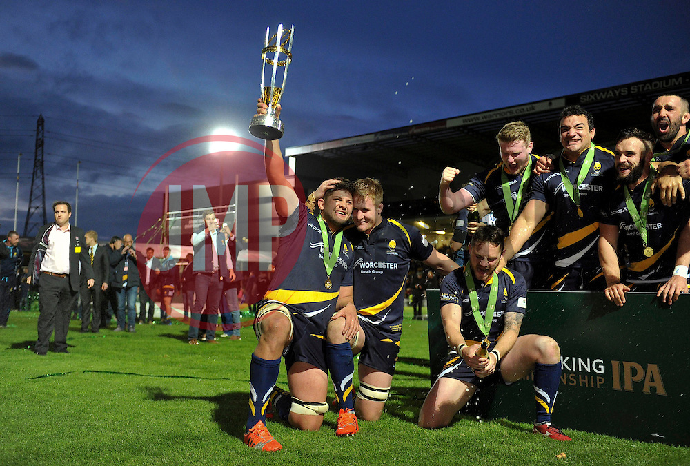 Mike Williams of Worcester Warriors lifts the Greene King IPA Championship trophy - Photo mandatory by-line: Patrick Khachfe/JMP - Mobile: 07966 386802 27/05/2015 - SPORT - RUGBY UNION - Worcester - Sixways Stadium - Worcester Warriors v Bristol Rugby - Greene King IPA Championship Play-off Final (Second leg)