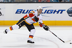 Feb 8, 2012; San Jose, CA, USA; Calgary Flames defenseman Scott Hannan (23) passes the puck against the San Jose Sharks during the first period at HP Pavilion. Mandatory Credit: Jason O. Watson-US PRESSWIRE
