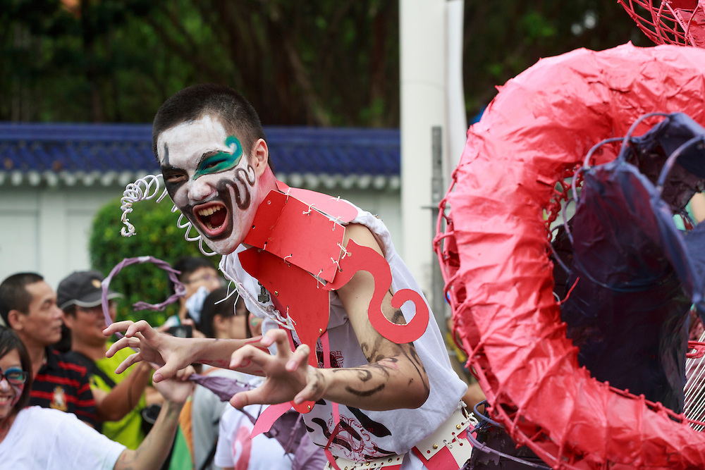 Painted faces at the Dream Parade, Taipei