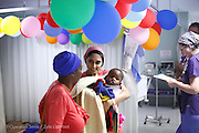 047, Keale Boga Sebego, 4 years old, Male, UCL, before, being carried to surgery by  Anesthesiologist	 Hashanti Moodliar. Keale travelled from Limpopo for 14 hours with Aunt Linkie to reach the mission.<br /> Rob Ferreira Hospital. Operation Smile South Africa&rsquo;s 2015 mission to Mbombela. South Africa.<br /> <br /> (Operation Smile Photo - Zute Lightfoot)