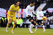 Derby County midfielder Tom Ince (23) and Sheffield Wednesday forward Atdhe Nuhiu (9) during the Sky Bet Championship match between Derby County and Sheffield Wednesday at the iPro Stadium, Derby, England on 21 February 2015. Photo by Aaron Lupton.