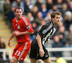 NEWCASTLE, ENGLAND - Sunday, December 28, 2008: Liverpool's Jamie Carragher and Newcastle United's Michael Owen during the Premiership match at St James' Park. (Photo by David Rawcliffe/Propaganda)