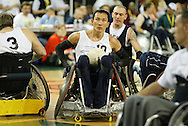 July 7th, 2006: Anchorage, AK - William Groulx looks up at the clock to check how much time is left before White defeats Blue in the gold medal game of Quad Rugby at the 26th National Veterans Wheelchair Games.