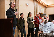Former 115th Fighter Wing commander Jeffrey Wiegand, left, speaks during the public listening session at the East Madison Community Center on the subject of F-35 fighter jets at Truax Field in Madison, Wisconsin, Wednesday, Feb. 28, 2018.