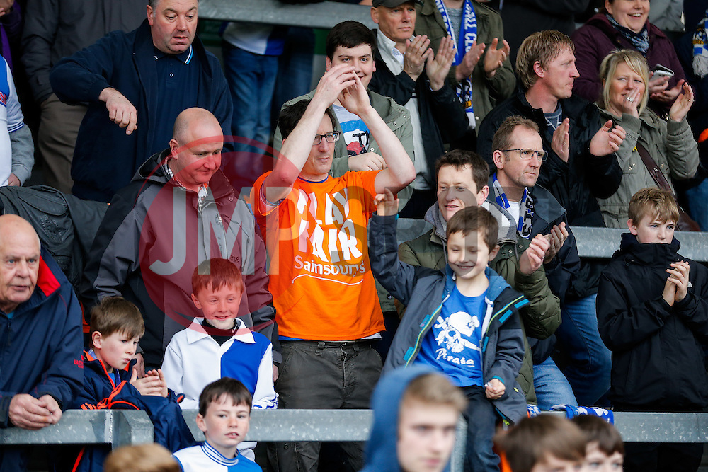 "Bristol Rovers supporters show their ""Play Fair Sainsbury's"" t'shirts to urge the supermarket to honor their deal to buy the Memorial Stadium and help fund the club's new stadium in Bristol - Photo mandatory by-line: Rogan Thomson/JMP - 07966 386802 - 03/04/2015 - SPORT - FOOTBALL - Bristol, England - Memorial Stadium - Bristol Rovers v Chester - Vanarama Conference Premier."