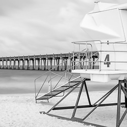 Pensacola Beach Pier and lifeguard tower four black and white panorama photo. Pensacola Beach is on Santa Rosa Island in the Southeastern United States of America. Panoramic photo ratio is 1:3. Copyright ⓒ 2018 Paul Velgos with All Rights Reserved.
