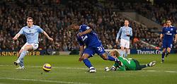 MANCHESTER, ENGLAND - Monday, February 25, 2008: Everton's Yakubu Ayegbeni and Manchester City's Richard Dunne during the Premiership match at the City of Manchester Stadium. (Photo by David Rawcliffe/Propaganda)