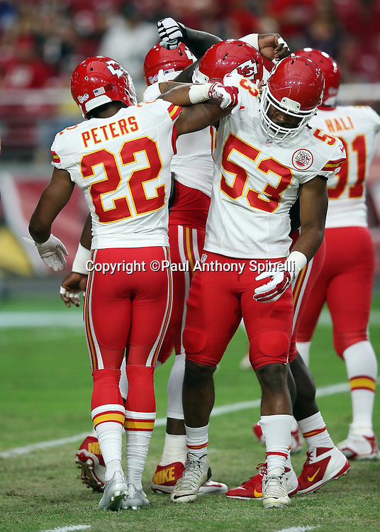 Kansas City Chiefs cornerback Marcus Peters (22) does a forearm bump with Kansas City Chiefs outside linebacker Ramik Wilson (53) before the 2015 NFL preseason football game against the Arizona Cardinals on Saturday, Aug. 15, 2015 in Glendale, Ariz. The Chiefs won the game 34-19. (©Paul Anthony Spinelli)