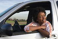 Portrait of mid-adult woman in car window