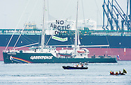 ROTTERDAM - A banner reading 'No Arctic oil!' hangs from Greenpeace's Rainbow Warrior docked next to the Russian oil tanker Mikhail Ulyanov Greenpeace's Rainbow Warrior protest against Russian oil tanker Mikhail Ulyanov delivering Arctic oil, Rotterdam harbour, Netherlands - 01 May 2014 Dutch police arrested around 30 Greenpeace activists, including the captain of the lobby group's iconic Rainbow Warrior, as they tried to stop the Russian tanker delivering Arctic oil from docking.  COPYRIGHT ROBIN UTRECHT