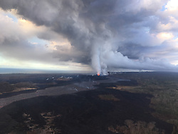 Handout photo of Fissure 8 and the proximal lava flow channel on the morning of June 29. Low fountaining within the cone is still producing a vigorous supply of lava to the channel. Kilauea Volcano, HI, USA, June 29, 2018. Photo by USGS via ABACAPRESS.COM