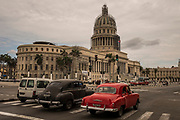 El Capitolio and the traditional old cars in Havana, Cuba.