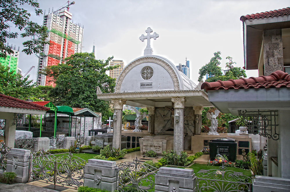 Celebration of traditional All Saints Day (Halloween) in Makati City's Manila South Cemetery, where friends and family of the departed visit gravesites and spend time (sometimes all night into the following day) to eat and reflect on long lost loved ones.