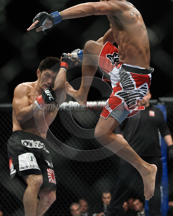 "BIRMINGHAM, ENGLAND, NOVEMBER 5, 2012: Michihiro Omigawa (left) defends a kick from Jason Young during ""UFC 138: Munoz vs. Leben"" inside the National Indoor Arena in Birmingham, United Kingdom"