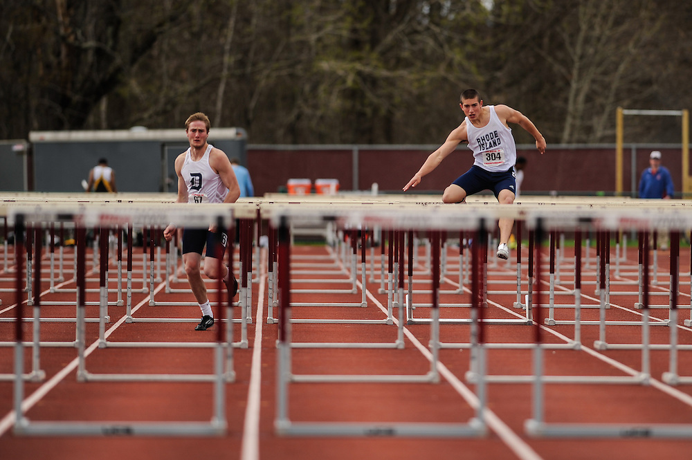 AMHERST, MA - MAY 4: Sean King of Duquesne University (67) and Jacob Moran of the University of Rhode Island (304) compete in the decathlon 110 meter high hurdles on Day 2 of the Atlantic 10 Outdoor Track and Field Championships at the University of Massachusetts Amherst Track and Field Complex on May 4, 2014 in Amherst, Massachusetts. (Photo by Daniel Petty/Atlantic 10)