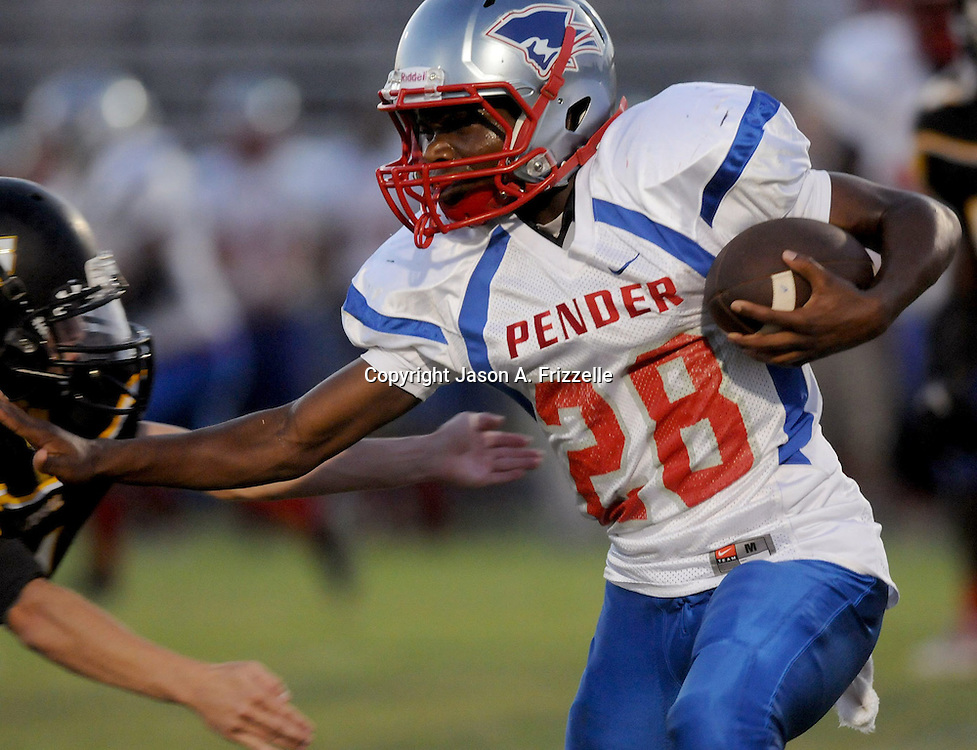Pender High School's Justin Hooper rushes against Topsail High School's John Covil Friday August 30, 2013 at Topsail High School. (Jason A. Frizzelle) This collection of images is from the 2013 High School Football in the Cape Fear region.