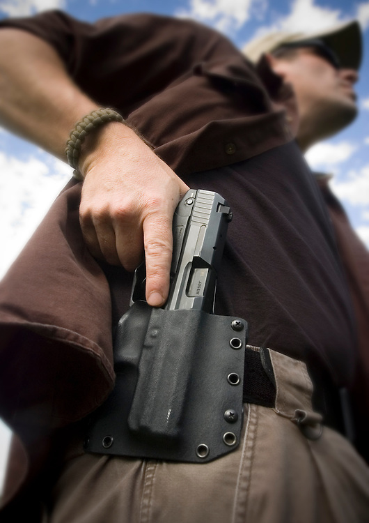 Heckler &amp; Kock USP 40 Compact,<br /> Raven Concealment Systems Phantom OWB Holster<br /> Photo by John Pavoncello
