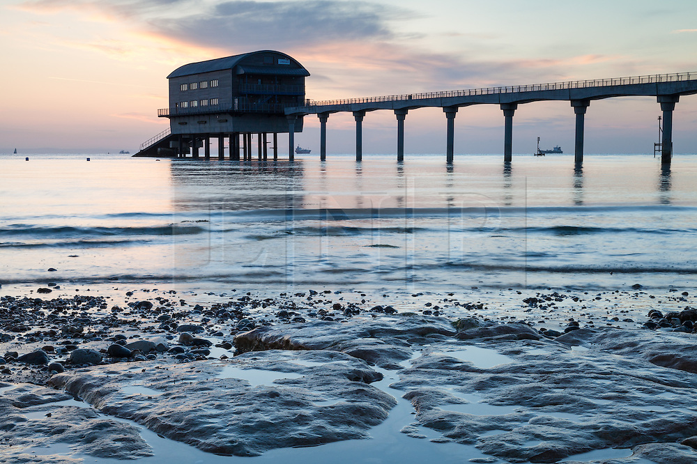 © Licensed to London News Pictures. 22/05/2015. Bembridge, UK. Bembridge lifeboat station seen at sunrise from Lane End beach on the Isle of Wight this morning, Friday 22nd May 2015. The Bank Holiday weekend is set to be warm with sunny spells in the South of England. Photo credit : Rob Arnold/LNP