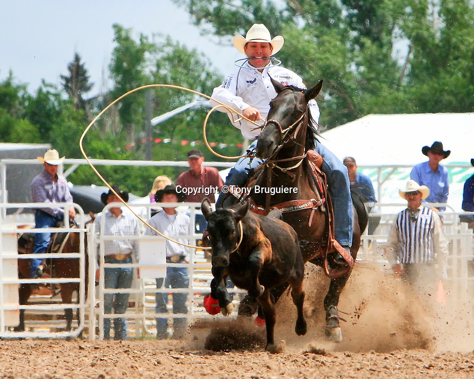 Seven time World Champion Trevor  Brazille competes in calf roping at the 2009 Cheyenne Frontier Days.