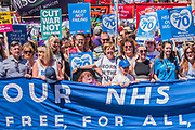 The front of teh march - #OurNHS70: free, for all, forever a protest and celebration march in honour of the 70 year history of the National Health Service. Organised by: The People's Assembly, Trades Union Congress, Unison, Unite, GMB, British Medical Association, Royal College of Nursing, Royal College of Midwives amongst others.