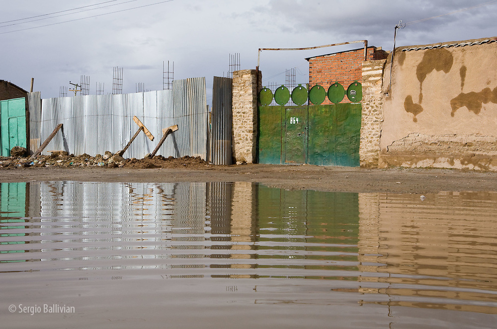 The flooded muddy streets of the city of Uyuni in Potosi, Bolivia. after a summer rainstorm.