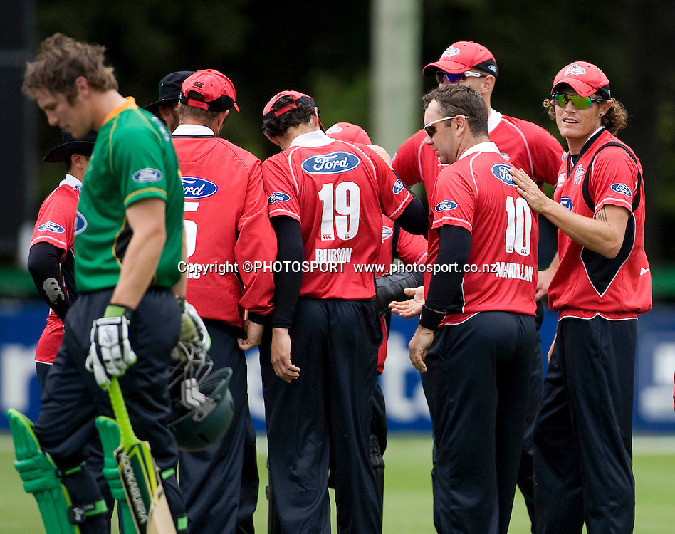 Canterbury Wizards celebrate the wicket of Jamie How, with Central Stags batsman George Worker in the foreground. Men's 1-Day, Canterbury Wizards v Central Stags at Mainpower Oval, Rangiora, Tuesday 08 December 2009. Photo : Joseph Johnson/PHOTOSPORT