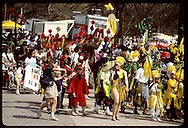Kids and adults march in Earth Day parade in colorful, homemade costumes; Forest Park, St. Louis Missouri