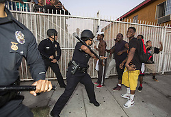 60133344 <br /> Protesters confront police officers during a demonstration to protest George Zimmerman s acquittal in the shooting death of Florida teen Trayvon Martin, in Los Angeles, California, July, 15, 2013. A Jury in U.S. state Florida on July 13 acquitted George Zimmerman, who shot and killed Seventeen-year-old African American teenager Trayvon Martin on Feb. 26, 2012, in a case which sparked heated debate on race and guns, Los Angeles, USA,<br /> Monday, 15th July 2013<br /> Picture by imago / i-Images<br /> UK ONLY