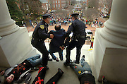 Jay Gillen, with the Algebra Project from Baltimore, is arrested by police as students lay at the doorsteps of the Maryland State Capital in Annapolis, Md, Wednesday, Feb. 6, 2008. The students _ who were calling for more funding for education _ were cuffed with plastic bands after trying to carry a fake cardboard coffin up the steps of the State House. (AP Photo/Glenn Fawcett, The Baltimore Sun)  ** MANDATORY CREDIT**  BALTIMORE EXAMINER AND WASHINGTON EXAMINER OUT** ORG XMIT: MDBAE101