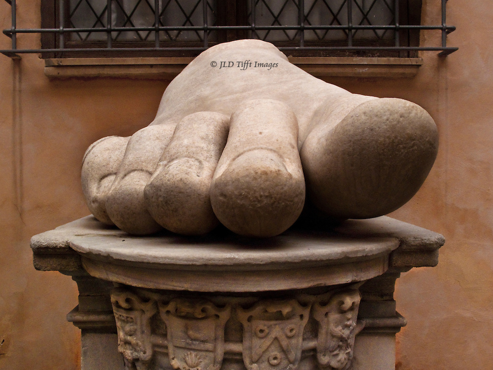 Constantine the Great, gigantic fragments on show at the Capitoline Museums.  Frontal view of a very large bare foot with five toes on a pedestal.