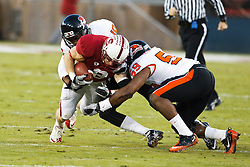 November 27, 2010; Stanford, CA, USA;  Stanford Cardinal wide receiver Ryan Whalen (8) is tackled by Oregon State Beavers linebacker Dwight Roberson (59) and safety Lance Mitchell (10)during the first quarter at Stanford Stadium.