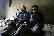 Free Syrian Army soldiers take a break from patrolling the farmland surrounding Al Janoudiyah, Syria.