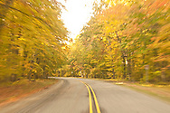 Driving H-13 a popular fall color tour in the Hiawatha National Forest of Michigans Upper Peninsula near Munising Michigan.