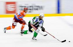 Burke Henry of Olimpija during ice-hockey match between HK Acroni Jesenice and HDD Tilia Olimpija in fourth game of Final at Slovenian National League, on April 8, 2011 at Arena Podmezakla, Jesenice, Slovenia. (Photo by Vid Ponikvar / Sportida)