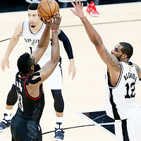 01 May 2017: Houston Rockets guard James Harden (13) takes a jump shot over San Antonio Spurs forward LaMarcus Aldridge (12) during the Houston Rockets 126-99 victory over the San Antonio Spurs, in game 1 of the Western Conference Semi Finals, at the AT&T Center, San Antonio, Texas, USA.