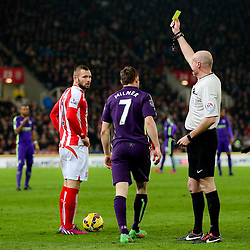 Manchester City's James Milner receives a yellow card  - Photo mandatory by-line: Matt McNulty/JMP - Mobile: 07966 386802 - 11/02/2015 - SPORT - Football - Stoke - Britannia Stadium - Stoke City v Manchester City - Barclays Premier League