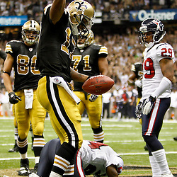 September 25, 2011; New Orleans, LA, USA; New Orleans Saints wide receiver Robert Meachem (17) celebrates following a touchdown catch during the third quarter against the Houston Texans at the Louisiana Superdome. The Saints defeated the Texans 40-33. Mandatory Credit: Derick E. Hingle
