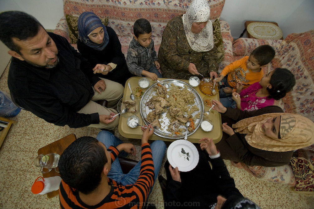 Abdul-Baset Razem, a Palestinian guide and driver, at a midday meal with his family in a Palestinean village in East Jerusalem.  (Abdul-Baset Razem is featured in the book What I Eat: Around the World in 80 Diets.)