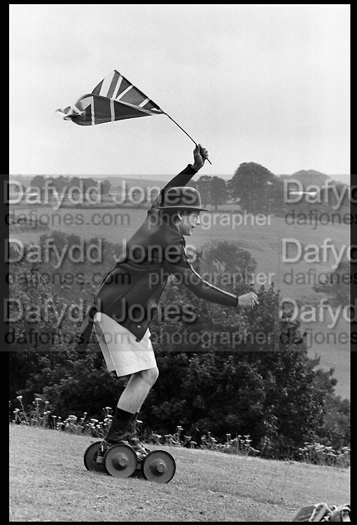 Crispin Balfour rolling along at the Dangerous Sports Club Tea party. Given at the Gloucestershire home of the Dutch Ambassador Robbert Fack. 22 August 1981. Film 8197f36