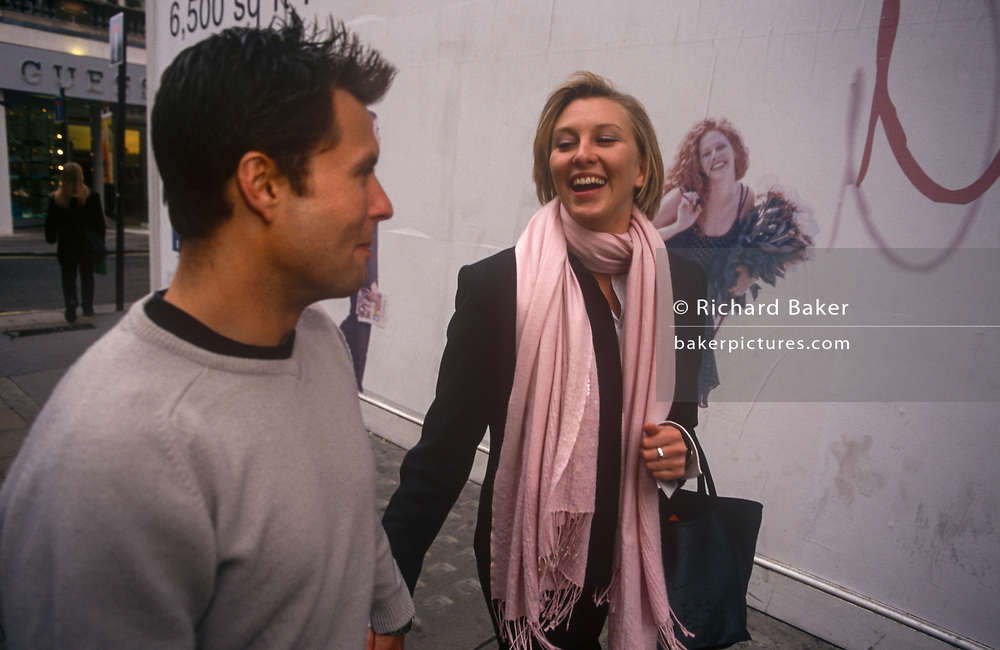 A couple enjoy the shopping experience in central London, on 21st September 1999, near Old Bond Street, london, England.