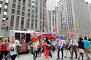 New Yorkers line up at the Good Humor Truck, Tuesday, June 24, 2014, to receive free Good Humor ice cream bars as part of a city-wide ice cream giveaway that will take place all summer in New York City.  (Diane Bondareff/Invision for Good Humor/AP Images)