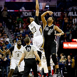 Mar 3, 2016; New Orleans, LA, USA; New Orleans Pelicans forward Anthony Davis (23) and San Antonio Spurs center Tim Duncan (21) jump for the opening tip off during the first quarter of a game at the Smoothie King Center. Mandatory Credit: Derick E. Hingle-USA TODAY Sports