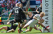 Twickenham. UK. Warwick LAHMERT, forces his way through to touch down by the posts during the England vs New Zealand Cup Quarter final match at the 2015. Marriott London Sevens. RFU Twickenham Stadium. Surrey. 16.05.2015. [Mandatory Credit: Peter Spurrier/Intersport Images]