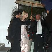 France, Cannes, Baz Luhrmann's 'Great Gatsby' is helps by her bodyguards on her way to the dinner party at the Agora, of the Palace de Cinema, Cannes Film Festival 2013.<br /> <br /> A hard rain did not stop the party.
