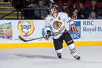 KELOWNA, CANADA - OCTOBER 4:  Josh Hanson #4 of the Portland Winterhawks skates on the ice against the Kelowna Rockets  at the Kelowna Rockets on October 4, 2013 at Prospera Place in Kelowna, British Columbia, Canada (Photo by Marissa Baecker/Shoot the Breeze) *** Local Caption ***