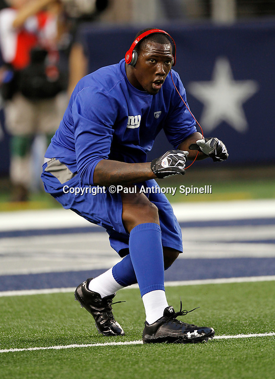 New York Giants defensive end Jason Pierre-Paul (90) warms up before the NFL week 7 football game against the Dallas Cowboys on Monday, October 25, 2010 in Arlington, Texas. The Giants won the game 41-35. (©Paul Anthony Spinelli)