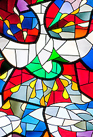 Ticino, Southern Switzerland. Modern stained glass window depicting a dove.